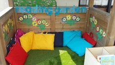 I love this for an outdoor reading area. I would add some real plants to this area though. Outdoor Learning Spaces, Kids Outdoor Play, Outdoor Play Areas, Kids Play Area, Eyfs Outdoor Area Ideas, Childrens Play Area Garden, Classroom Reading Area, Outdoor Classroom, Reading Areas
