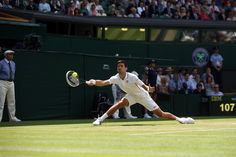Novak Djokovic slides cross to reach a forehand - Scott Heavey/AELTC