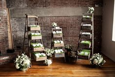 Stepladder, vintage crate and grass escort card display | Chic Red Hook Brooklyn Liberty Warehouse Wedding Filled With Billowy Blooms & True Love | Brookelyn Photography  http://www.storyboardwedding.com/chic-red-hook-brooklyn-liberty-warehouse-wedding/