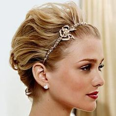 I like this hairstyle but maybe a little more tousled and of course with a veil in back
