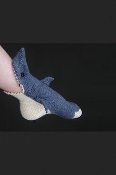 Knitted shark socks :)  Lisa Grossman at  http://www.boredpanda.org/shark-socks-tsarina-tsocks/