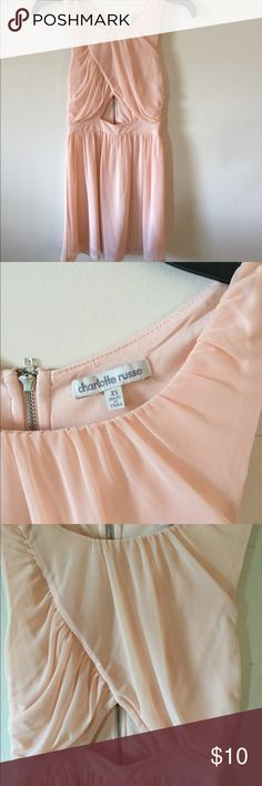 Charlotte Russe Dress Light pink, triangle cut out in the center, and zipper up the back, it's fitted around the top and loose around the bottom half Dresses Mini