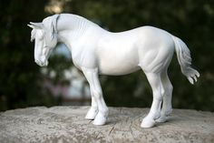 This listing is for an UNPAINTED resin. This mare is a sculpture that I created for Collecta, a company that is producing collectible replica