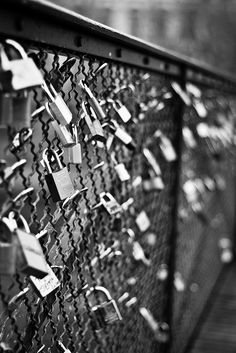 Love Locks Fence - Paris. Couples write their name on a padlock, lock it on the fence and throw the key to the river below. Even if they go their own ways it is a place that still symbolizes the time they shared together.