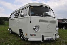 Really nice, lowered early bay vw bus. Would love this camper, though expensive.