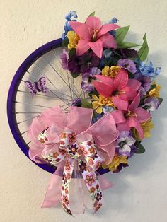 Spring Floral Bicycle Wheel Wreath with Butterfly; Just Jenn Home Arts; https://www.etsy.com/listing/527494395/spring-floral-bicycle-wheel-wreath-with