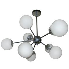 Chrome Nine-Arm Sputnik Chandelier, Mid-Century Hanging Lamp | From a unique collection of antique and modern chandeliers and pendants  at https://www.1stdibs.com/furniture/lighting/chandeliers-pendant-lights/