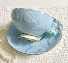 Flower Handle Royal Paragon China Tea Cup & Saucer Art Deco by NicerThanNewVintage on Etsy https://www.etsy.com/au/listing/489485377/flower-handle-royal-paragon-china-tea
