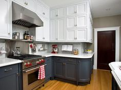 White and navy cabinets, marble counter tops. Gorgeous combo! http://www.hgtv.com/kitchens/top-countertop-materials-for-the-kitchen/pictures/page-4.html?soc=pinterest