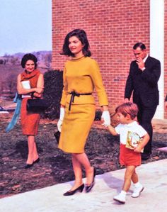 Jackie Kennedy leaving church with John Jr. in Middleburg, Virginia on October 27, 1963.  UPI reporter Helen Thomas is at the left,