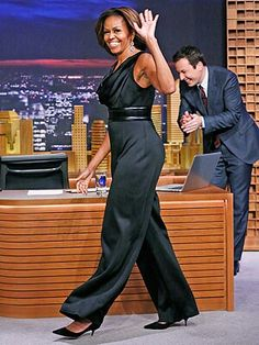 Fierce First Lady Michelle Obama wearing a black HM jumpsuit on The Tonight Show 2014 Michelle Obama Flotus, Michelle Obama Fashion, Barack And Michelle, Black Jumpsuit, Joe Biden, Durham, Barack Obama Family, Obamas Family, First Ladies