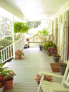 Front Porch - wish mine were a bit bigger like this.  My rocking chair is a tight fit between brick and front rail.
