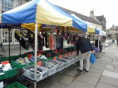 One gentleman reaches for a new pair of socks at Corsham market