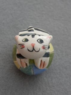 Ceramic cat on the ball