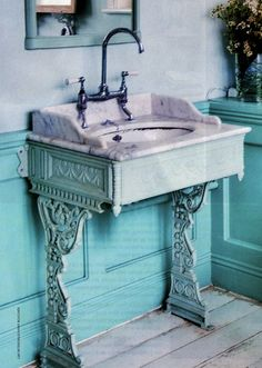 take an old singer sewing machine and turn it into a base for an old marble sink/bathroom vanity