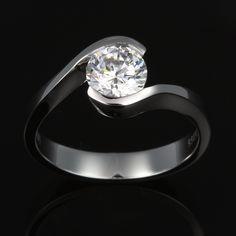 Semi-bypass white gold custom diamond engagement solitaire. Elegance in gold.