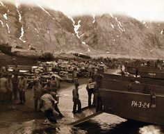 80-G-50921: Aleutian Islands Campaign, June 1942 - August 1943. Unloading supplies on invasion beachhead, Attu, on the day of the attack, May 14, 1943. U.S. Navy Photograph, now in the collections of the National Archives. (2016/05/10).