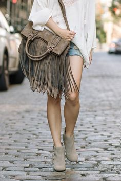 Swingy bronze foldover tote  with lots of fringe!