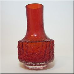 Whitefriars ruby red glass 'Mallet' vase, from the 'Textured' range, designed by Geoffrey Baxter, pattern number 9818.