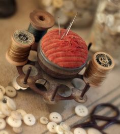 pincushion, thread and buttons