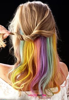 The Hidden Rainbow Hair Trend Do you know about the hidden rainbow hair trend? This is a part of the rainbow colored hair that is hidden beneath the strands of hair. The rainbow colored hair is made with seven colors and it is multicolored. So how cool does a hidden rainbow color hair look like? #colorful #hair #rainbowhair #colorfulhair #colored #coloredhair #rainbow $hairstyle