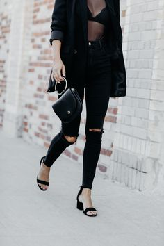 easy holiday outfit: jeans, blazer, and sheer top