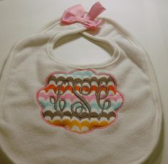 Personalized, embroidered, appliqued bib for babies.