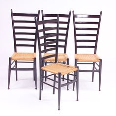 Gio Ponti four tall ladder-back chairs with woven (02/01/2005)