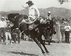 Casey Tibbs riding saddle bronc while blindfolded.