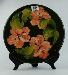 Collectors & General Auction – Lot 961 – Moorcroft Hibiscus on green ground charger 31cm.  Sale Price £45.00