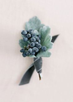 Berries, dusty miller and blue -grey velvet ribbon makes a pretty bout!
