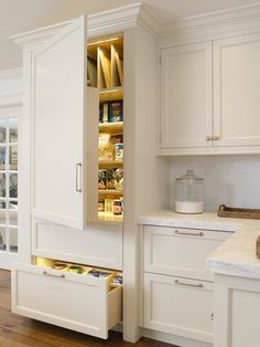 white-kitchen-marble-counter-lighted pantry with platter dividers