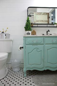 Farmhouse bathroom renovation ideas! Love this farmhouse bathroom remodel with classic finishes and timeless flooring.