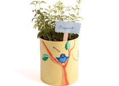 Make these charming tin can herb pots and watch them grow all summer long! This project not only recycles, it creates new life, and is a great Earth Day craft.