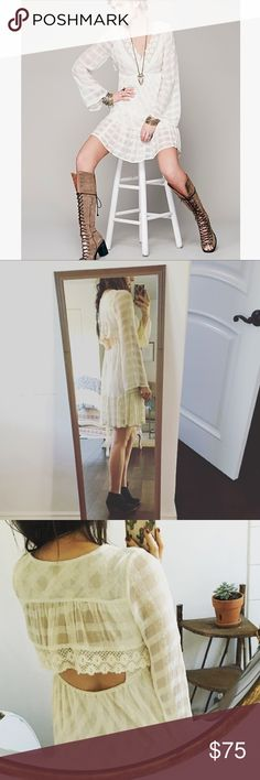 White Free People Dress Gorgeous off white flowy dress from free people. Very light weight delicate material, open back, beautiful details. 100% rayon. Worn a couple of times. Color is an off white kind of creme. The second and third photos more accurately represent the true color. Free People Dresses Long Sleeve