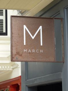 March #signage Rusted bronze sign & fresh simple white logo