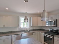 Fun lighting fixtures in this new home. #ranch #singlestory #lighting #kitchen