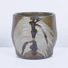 SHOJI HAMADA Tea Bowl Stoneware, olive green glaze with iron painted stem leaf motifs over thickly brushed white slip splashes, together with a signed wooden box