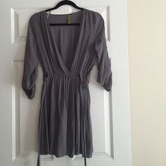 """Slate blue gray dress tunic This is so gorgeous!! The color is just perfect. It's lines on the inside. 100% rayon. 32.5 inches long from shoulder to bottom. I'm 5'7"""" and I had to wear with leggings or it'd be really short but I bet this could be worn as a dress if you're a little shorter. fits S best but the waist is elastic so it can fit xs-Med :) brand is whisper! Bought at a small boutique :) I'm open to offers, but I won't go too low on this one bc I'm still trying to decide if I want to…"""