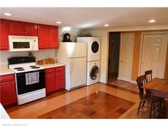 Small house interior- Like the red cabinets and w/d in kitchen (though maybe not right next to fridge...)