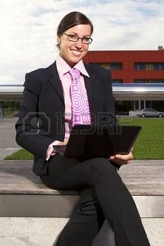 Business woman in the tie suit