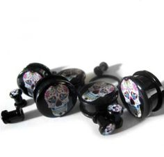 0 Gauge (8mm) Day Of The Dead Plugs - Sold As Pair . $13.00. Sold as a pair. Single Flare. Day of the dead logo