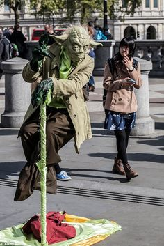 Fighting they are! Yoda Wars break out as Romanian street performers dressed as the Star Wars character battle each other for the most lucrative pitches in Trafalgar Square - Street I Am - Star Wars Characters, Fictional Characters, Street Performance, Trafalgar Square, Street Culture, Pitch, Battle, Stars, Sterne