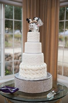 white wedding cake with disney wedding cake topper  ~  we ❤ this! moncheribridals.com