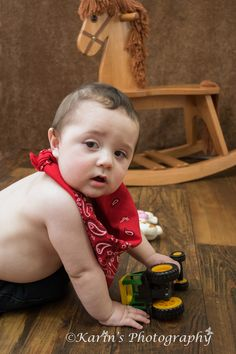 Baby photo shoot , farmer's boy.