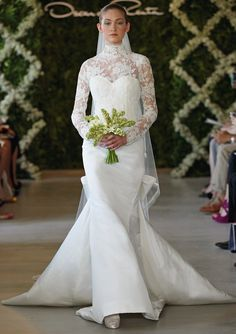 Oscar de la Renta Bridal 2013 ~ Ivory silk faille sweetheart trumpet gown with long sleeve corded Chantilly lace overlay