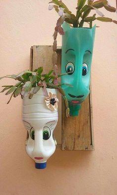 plastic bottle art DIY Face Shaped Painted Plastic Bottle Planters - Balcony Decoration Ideas in Every Unique Detail Plastic Bottle Planter, Reuse Plastic Bottles, Plastic Bottle Crafts, Garden Crafts, Diy Crafts, Upcycled Crafts, Recycled Decor, Hanging Flower Pots, Flower Garden Design
