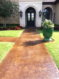 Make an entrance! This was done using DCI Cola Concrete Acid Stain.