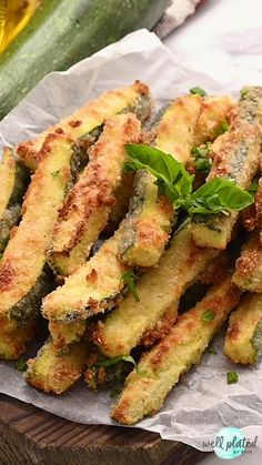These easy oven baked Zucchini Fries with Parmesan and Panko are just as crisp as fried fries for a fraction of the calories! A healthy, kid-friendly side dish or appetizer. Serve them with a basil yogurt dip, marinara sauce, or enjoy them all on their own. Zucchini Fries Baked, Zucchini Pommes, How To Bake Zucchini, Fried Zucchini Sticks, Oven Fried Zucchini, Zucchini Parmesan Crisps, Zucchini In The Oven, Oven Baked Fries, Zuchinni Recipes