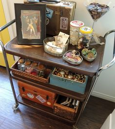 My favorite corner of the Beehive - Scrapbook.com- a vintage cart for useful and decorative craft storage!